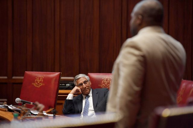 Senate Minority Leader Len Fasano, R-North Haven, left, listens to State Sen. Gary Winfield, D-New Haven, right, during special session at the State Capitol, Tuesday, July 28, 2020, in Hartford, Conn. (AP Photo/Jessica Hill)